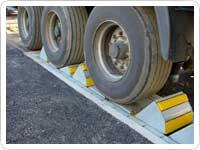sistema de calzos automaticos para muelles de carga industriales